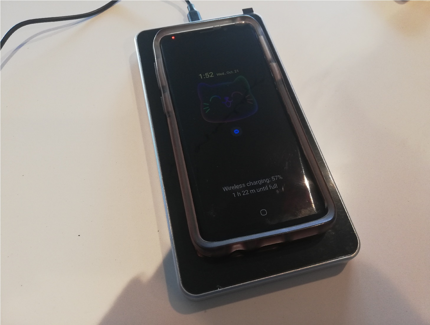 image of a phone charging on the wireless charging pad surface
