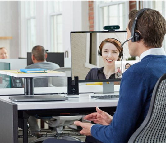 Office workers conducting a conference call with a logitech webcam