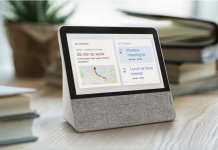 image of the Lenovo Smart Display sitting on a desk with books