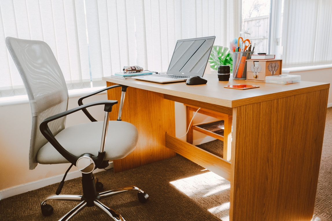 image of an ergonomic office chair in front of an office desk