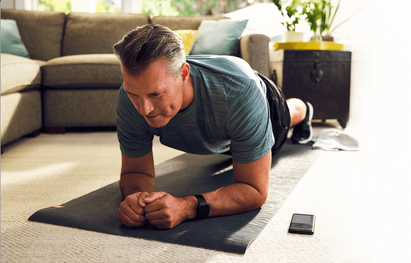 image of a man doing a planking exercise in his home