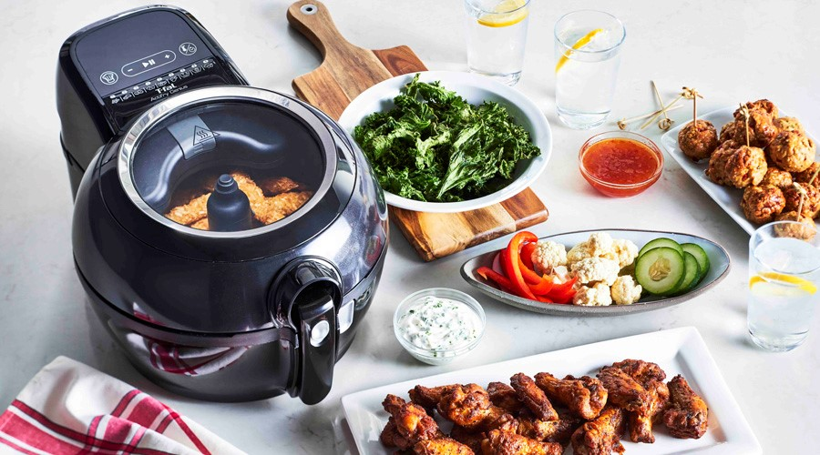 image of a T-fal air fryer surrounded by healthy delicious food