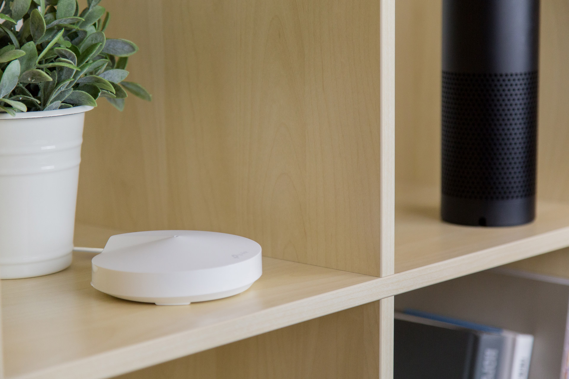 The TP-Link Deco M5 Mesh Router placed on a shelf