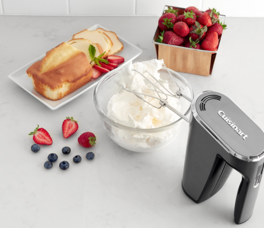 Image of the Cuisinart Cordless Hand Mixer mixing a bowl of cream with fruit and cake nearby