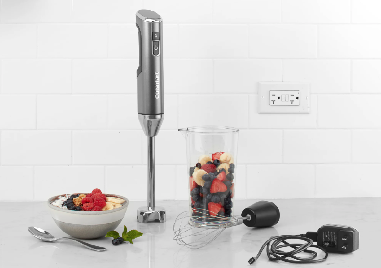 image of the Cuisinart Cordless Immersion blender with whisk attachment and cord nearby, and measuring beaker filled with fruit