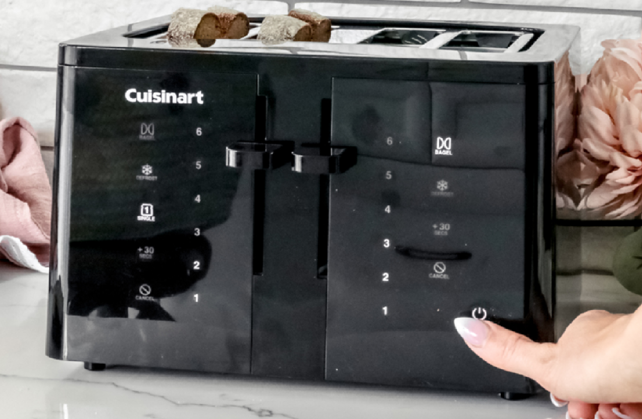 image of a hand pressing a touchscreen button on the Cuisinart 4-Slice Touchscreen Toaster