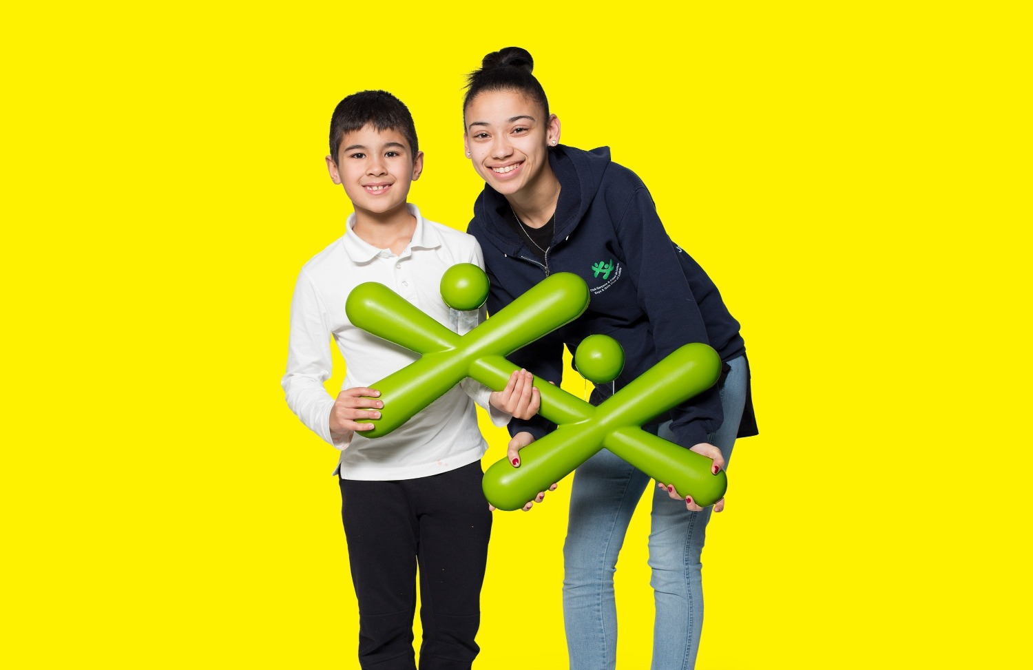image of 2 kids holding up the Boys and Girls Club logo