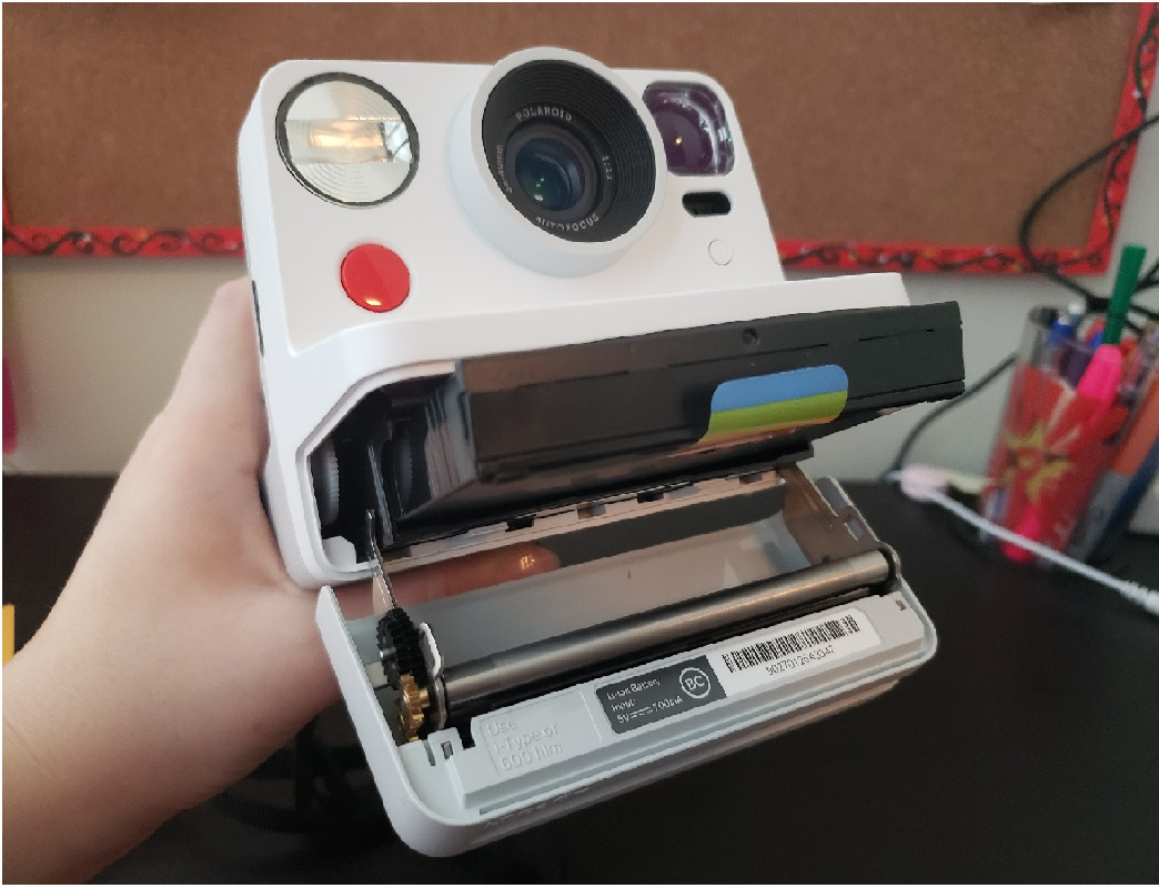 image of the Polaroid Now with the film compartment open