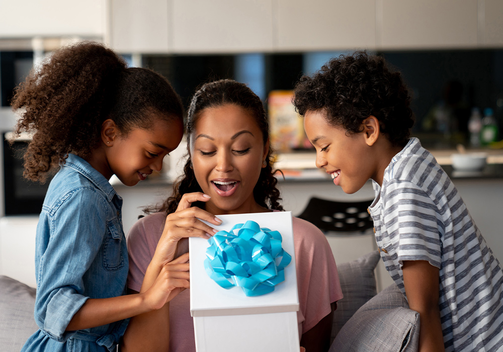 image of a mom opening up a gift