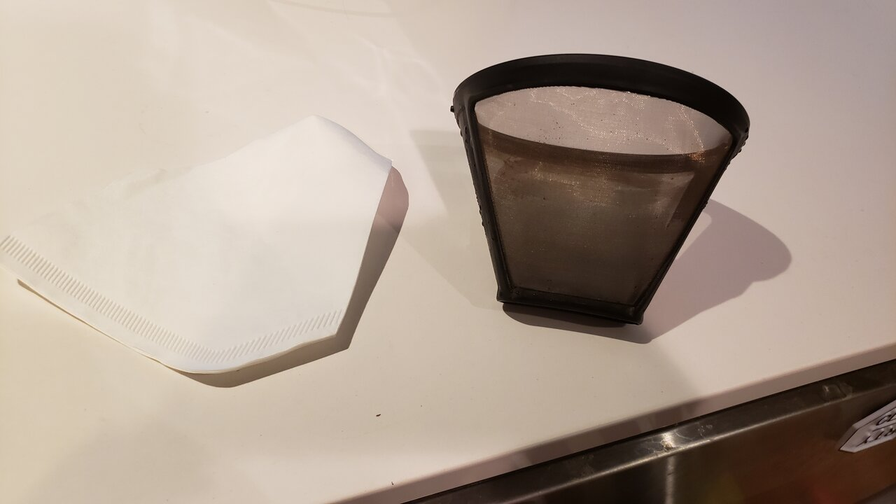 image of a paper filter next to the reusable filter