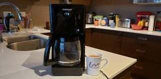 image of the coffee maker next to a mug of coffee