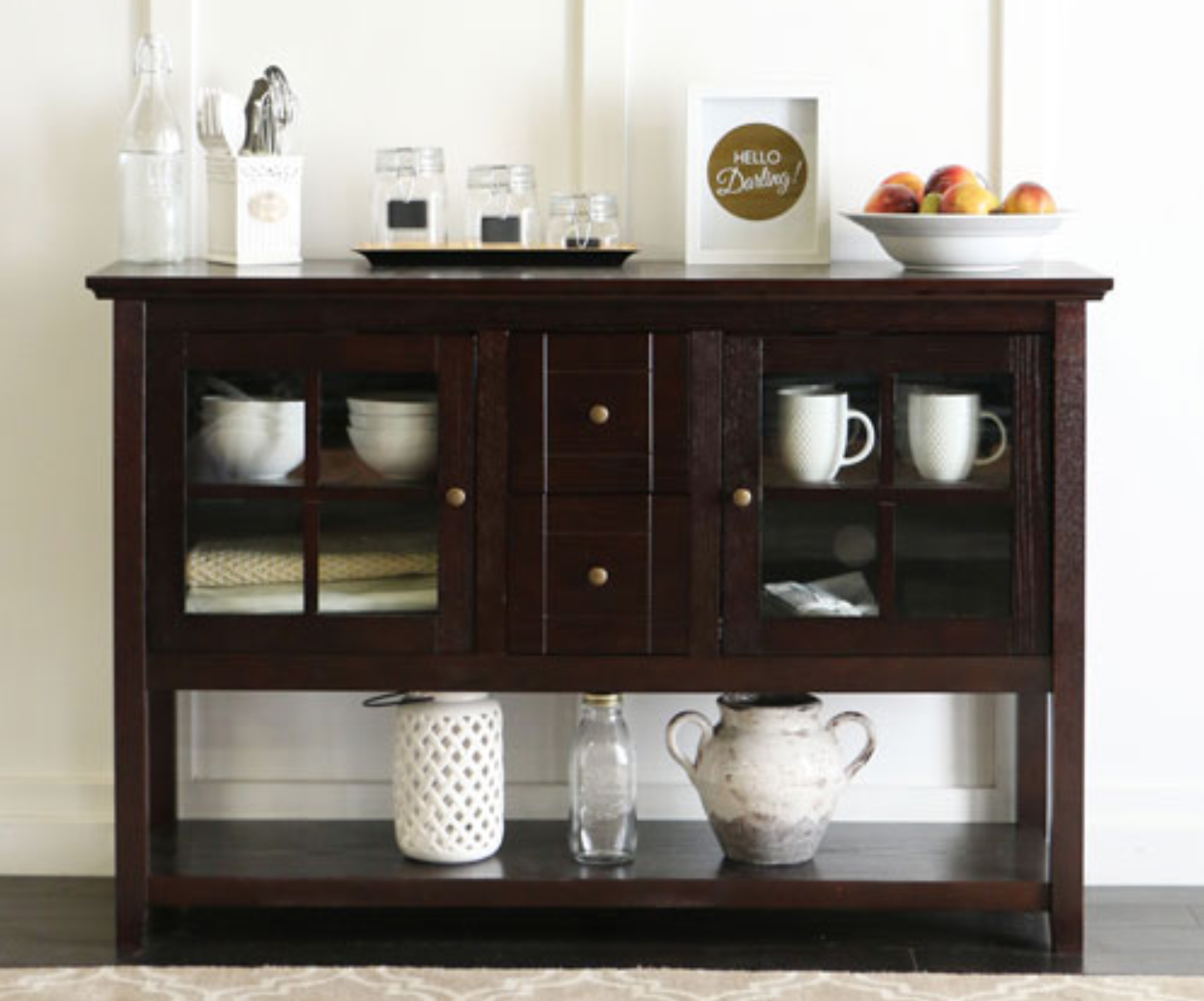 image of a kitchen buffet holding dishes and decor