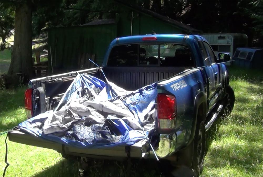 Napier tent setup showing main poles inserted