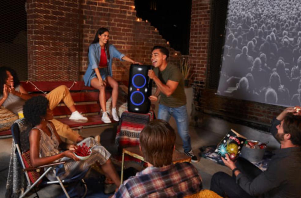 group singing karaoke with the JBL PartyBox speaker