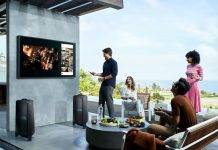 A family enjoying the Samsung The Terrace TV