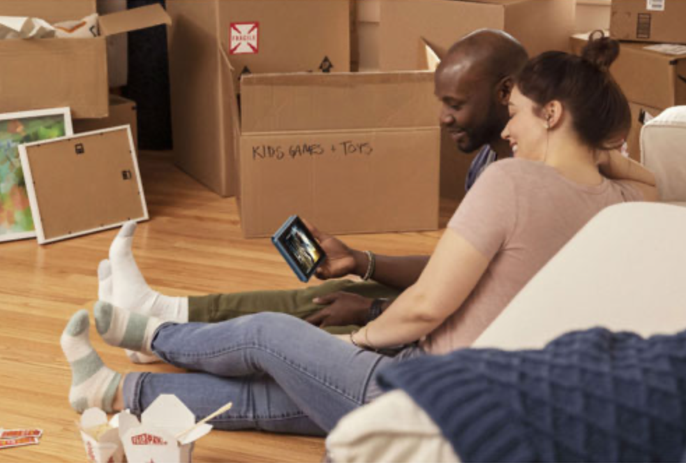 Couple with Amazon Fire 7 tablet
