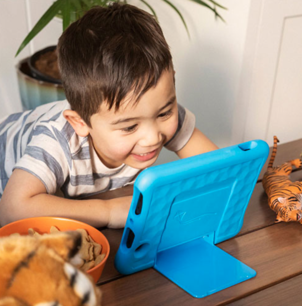 Young boy with Amazon Kids Fire tablet