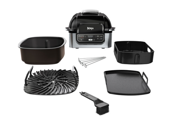 an indoor grill/sandwich press with all the removable, washable parts laid out