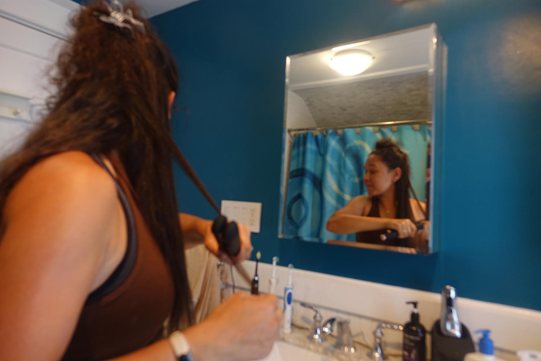 Looking in the mirror straightening my hair