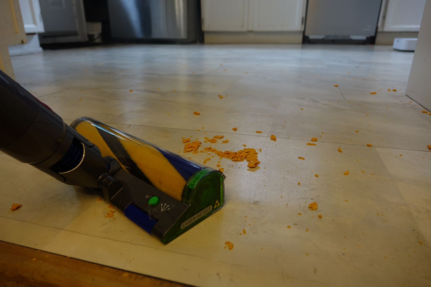 Dyson V15 Detect cleaning crumbs.
