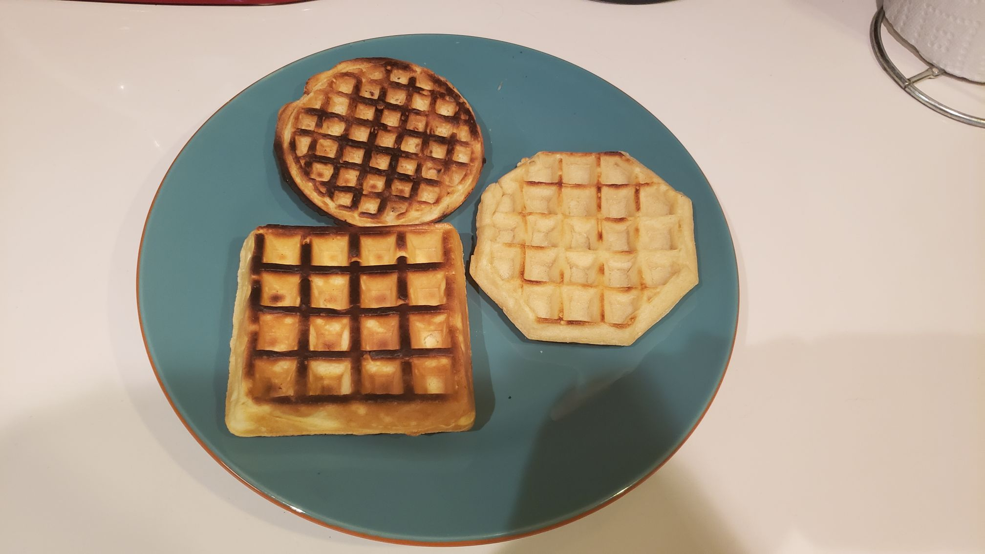 3 types of waffles on a plate, 2 of them are overcooked