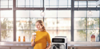 Phillips 2200 espresso machine with woman in the background.