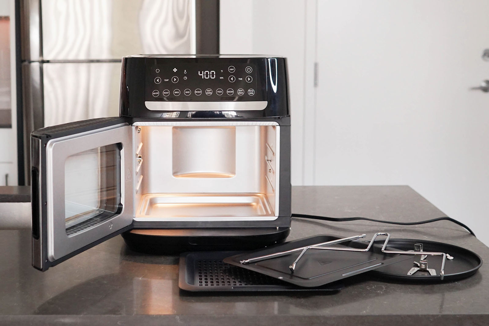 Bella Pro air fryer pizza oven on the counter.